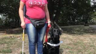 Хриси Пачалова и куче водач Рейвън